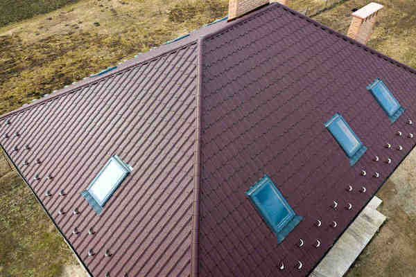 Commerical building with brown roof and blue skylights in Denton County, Texas.