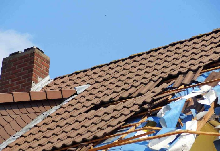 Denton County residential roof damaged by storm.