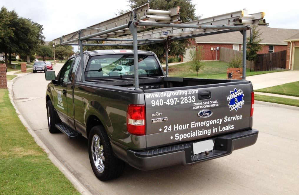 DKG Roofing truck parked in front of customer's home.
