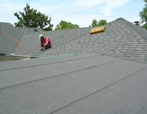 Denton Country a roof with roll roofing being applied